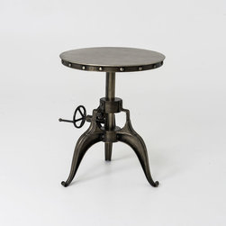 Four Hands - Exotic Crank 22 End Table - A perfect illustration of precise engineering, this Exotic Crank 22 End Table is configured with an intricate mechanism for adjusting the height of the table. The round top is smoothed to flat and lustrous surface that mounts on a tripod stand through a swiveled joint. The circumference of the table top is detailed with an array of pins to accentuate the overall appearance. Suitable for placing at the corners of your living room or party halls.