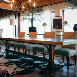 Canal Street Residence - Hot rolled steel and cherry dining table with brass inlays.