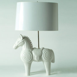 Jonathan Adler Horse Lamp in Ceramic Menagerie Lighting - Oh, my mind is swimming with Trojan War and Mr. Ed taglines but I'll spare you. This horse is classic, contemporary, a bit regal and a bit cheeky – kind of like Fergie back in the day, when she and Di used to poke people in the bums with umbrellas.