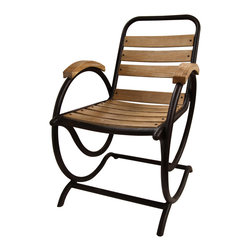 Volute Armed Rocker - Combining form and function for a practical, whimsical indoor-outdoor furniture piece, the Volute Armed Rocker has an outer frame consisting of sleek metal loops which arch above the seat to support wooden armrests that match the chair's slats, then dip down to meet the portion of the frame that rests on the floor. The slats and armrests are softly antiqued, matte natural wood - a classic look given unexpected impact by unusual construction.