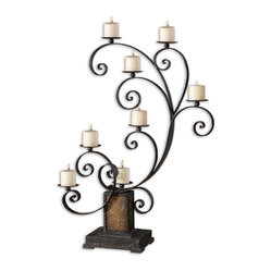 Uttermost - Kara Aged Black Metal Candelabra - With its aged patina and golden glass pedestal, this tall black metal candelabra is ready to set a shining romantic glow around your dining room or foyer. Or imagine the Old World ambience the stunning scrollwork and six pillar candles will add to your fireplace hearth or mantel.