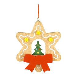Alexander Taron - Christian Ulbricht Ornament-Christmas Tree in Gingerbread Star-3H x 2.5W x 0.25D - The wooden star-shaped Gingerbread cookie hanging ornament has a Christmas tree in the center. Yellow stars - a large red ribbon - and a drizzle of white frosting accents the outline. Made in Germany by Christian Ulbricht.