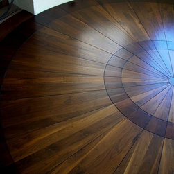 Hand scraped prefinished custom walnut plank - Custom milled & prefinished Black Walnut Plank flooring & medallion for circular nook...available in solid or engineered construction.