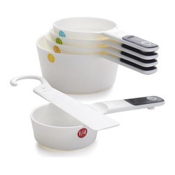 OXO® 5-Piece Measuring Cup Set - OXO's clever cups snap together for compact storage, accompanied by a convenient hanging hook that doubles as a scraper for leveling ingredients. Each plastic cup with soft-grip handle is identified by a colorful dot and features a halfway marking to provide even more measurement options.