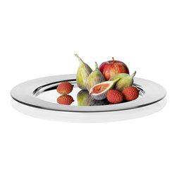 Sarpaneva Stainless Steel Charger - The largest circular steel disk of the Sarpaneva line, the Stainless Steel Charger measures a full 16'' across. It can also be of use as a breathtaking platter or centerpiece, bending light from a batch of Kivi votives or framing a tantalizing fruit arrangement.