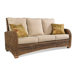 Wicker Paradise - St Kitts Seagrass Sofa - Sunbrella Antique Beige Cushions - Our elegant Seagrass sofa has a refreshing mix of beige and brown tones. It features a high back and a wicker lining along the base for a finished look. The sofa is built with a double-wall construction on a solid wood frame with wooden legs. The mix of seagrass, wicker, and wood, combined with the long, clean lines of the furniture gives this piece an eclectic, modern edge. This seagrass sofa is perfect for living rooms, covered porches, screened-in-porches, beach homes, and any covered area! The solid wood frame, paired with support straps and decking underneath the bottom cushions provide additional strength and support. The sofa includes Sunbrella fabric cushions in Antique Beige.