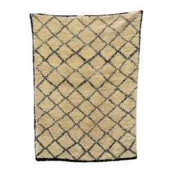 Pre-owned Criss Cross Vintage Beni Ourain Rug - You've seen reproductions of this stunning rug in current decor stores and in design magazines - but this is the real deal. Hand woven in the Atlas Mountains of Morocco by the Beni Ourain tribe, the pile of this off-white and black wool rug is even in both density and height. With simple harlequin patterns and tribal graphics, this piece pairs well with Contemporary, Modern or Mid-Century style spaces.