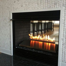 Modern Indoor Fireplaces by Kara O'Connor Interiors