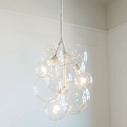 Pendant Bubble Chandelier - The Pendant Bubble Chandelier consists three bulbs, two 4″ and six 6″ glass globes. The Pendant is available in natural coiled cotton with porcelain sockets. Upgrades with polished nickel or natural brass cups, white or brown leather coiling are also available.