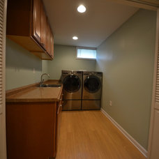 Traditional Laundry Room by Basement Masters
