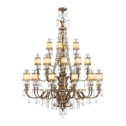 Livex Lighting - Livex La Bella 8910-65 Chandelier - Vintage Gold Leaf - 60-watt in. - 8910-65 - Shop for Chandeliers from Hayneedle.com! Reflecting the timeless elegance and refined charm of traditional aesthetics the Livex La Bella 8910-65 Chandelier - Vintage Gold Leaf - 60-watt in. is just what you need to illuminate your foyer or formal dining space in style. Pretty crystal accents add a dash of femininity to the hand crafted drum-shaped gold-dusted glass shades which coordinate beautifully with the vintage gold leaf finish to create a piece that's rich in both style and substance. This three-tier 60-inch chandelier uses twenty-four 60-watt candelabra base bulbs (not included) to fill your space with a warm ambient glow and comes with 72 inches of chain and 180 inches of wire for installation. Professional installation is recommended.About Livex LightingLivex Lighting is a manufacturer and distributor of decorative residential lighting. The company was founded in 1993 and is now headquartered in a 150 000-square-foot facility in Morristown New Jersey. Livex Lighting currently offers over 2 500 products ranging from lighting fixtures for indoor and outdoor applications to lampshades chandelier shades ceiling medallions and accent furniture. The goal of Livex Lighting is to provide the highest-quality product at the most affordable price. We are constantly responding to the ever-changing needs styles and fashions of the lighting industry while always maintaining the highest standards of quality.