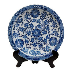 Oriental Unlimited - 14 in. Dia. Floral Blue & White Porcelain Pla - Chinese decorative charger, for dry use only. Often displayed upright on a folding wood stand. Beautiful decorative display on a buffet, server or break front. This item is shot with the stand for illustration purposes, the stand is sold separately. Please select the 14 in. size of Rosewood Plate Stand.. 14 in. Dia. x 2 in. H (5.5 lbs.)