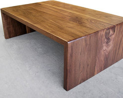 Brandner Design Custom Furniture - Our Walnut Waterfall Coffee Table is simply that ... Black Walnut boards that flow to the floor.  Beautifully hand crafted and seamlessly joined with the grain of each board running continuous through the table.  Available as a coffee table or desk.  Please contact us at sales@brandnerdesign.com.