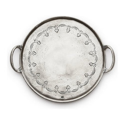 Vintage Pewter Round Tray with Handles - Made with traditional techniques by craftsmen in Italy, the Vintage Pewter Round Tray with Handles is useful for keeping bottles together on the bar or in the bath, and it provides a graceful way to easily serve an amuse bouche. However you use this handsome pewter tray, though, you'll find you want to dress it lightly so the elegant trefoil garland engraving remains visible.