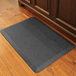 Frontgate - WellnessMats Granite Comfort Mat - A no-trip, 20 degree beveled edge is ADA-rated wheelchair compliant. The 7-year warranty guarantees your mat will remain comfortable, lay flat, and never separate, bubble, compress, or discolor. Puncture, heat, stain, and dirt resistant. Maintain with any household cleaner. Anti-microbial. Our WellnessMats Granite Comfort Mat has a remarkably resilient core, providing safety and comfort to those required to stand for long periods of time. This is the mat of choice for several hotels, airports, professional kitchens, and retailers. . .  .  .  . Safe and non-toxic (PVC-free) . Easy to clean – simply maintain with household cleaner. Made in the USA.