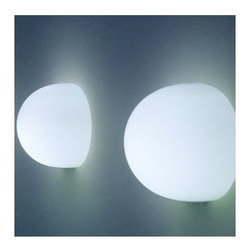 Flos Lighting - Glo-Ball Wall Sconce by Flos Lighting - A wall sconce with remarkable spherical style. The Glo-Ball Wall Sconce features half a sphere of hand-blown, acid-etched Opaline glass. The halved shape allows the Glo-Ball to glow brightly in all directions while still mounted flush to the wall. Part of the Flos Glo-Ball collection, designed by Jasper Morrison.Flos was first established in 1962 in Merano, Italy, to produce high quality modern lighting. This Italian lighting company continues to do so to this day by collaborating with talented international designers and researching the latest lighting technologies and materials. Resulting Flos lighting fixtures are daring and provocative, yet uphold the fundamental principles of good design.The Flos Glo-Ball T1 Table Lamp is available with the following:Details:Hand-blown, acid-etched, flashed Opaline glass shadeSteel baseUL ListedMade in ItalyDesigned by Jasper Morrison, 1999Lighting:One 100 Watt 120 Volt T10 Halogen lamp (included).Shipping:This item usually ships within 3 to 5 business days.