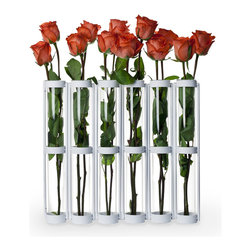 "Danya B. - Six Wide Tube 16"" Tall White Hinged Vases - This hinged vase with six 16"" glass vials on a metal stand is easy to arrange with just a few flowers. Hinges allow you to set vase different ways for a playful accent. Set a few together for an elongated effect, or wrap it around  for adifferent effect. With this unique and simple design anyone can crate beautiful arrangements to go on a mantel or buffet table in minutes without proper floral training!"