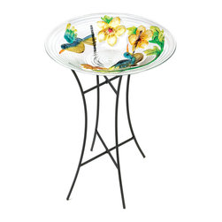 KOOLEKOO - Lush Garden Birdbath - A tempered-glass bowl with brightly colored birds and foliage bring about the scene of a cheery morning in a lush garden. The streamlined metal stand puts a modern twist on the classic birdbath, and the tropical hues will create a happy watering spot for the birds in your neighborhood.