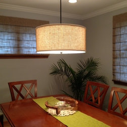 Reverse classic roman shades - Reverse classic roman shades inhance the casual atmosphere of this Arlington Heights dining room.