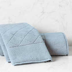 "Frontgate - Resort Quilted Hand Towel - Woven to a plush 600 gsm. Long-staple Turkish cotton is finely combed for a smooth, soft feel. Hydrocotton towels are produced through an advanced weaving technique that creates low-twist loops and results in superior absorbency and softness. These quick-drying towels will gain a more luxurious hand over time. 4"" dobby accommodates a monogram of up to three letters. Made of the same luxurious and lofty Turkish cotton as our solid Resort Bath Towels, our Quilted Towels are a woven with an elegant diamond pattern. This premium towel is woven to a plush 600 gsm through an advanced Hydrocotton weaving technique that results in superior absorbency and softness.  .  .  .  .  . Pair with our solid Resort washcloth set and bath mat . In Chambray, Eucalyptus, Fog, Harvest, Ivory, Linen, Orchid, Spruce, White and Nectar . Made in Turkey. Please note, personalized items are nonreturnable."