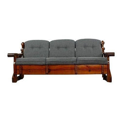 "Pre-owned Vintage Rustic Knotty Pine Sofa - Vintage rustic sofa with new upholstery. Steadfastly constructed with solid knotty pine wood. The original dark walnut color stain adds richness. Newly upholstered in slate colored tweed fabric. Thick cushions suit today's standard for comfort.     Matching rocking chair, arm chair, bench ottoman, and side chairs available (sold separately). New upholstery. Wood frame is clean except to nicks on the back (see photos).    Seat height measures 18""."