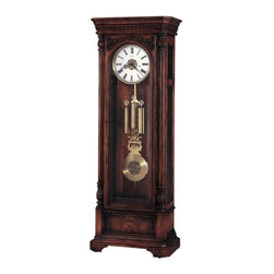 Howard Miller - Howard Miller - Trieste Floor Clock - Think of the classic grandfather clock experience with this stunningly crafted and matchlessly designed Hampton cherry floor clock featuring triple chimes and brushed antique brass bezel accents. * This impressive, highly detailed floor clock captures the style of Southern European traditions. A multi-tiered, flat-top pediment features canted corners with decorative dentil molding. . The finish is distressed for an aged appearance. . The door features an acanthus overlay with a raised molding framing the door glass, flanked by columns with large reeds and intricately carved column caps. . A brushed antique brass bezel surrounds the soft cream dial, accented with a decorative antique gold finished center disk. Black Roman numerals and serpentine hands complete the elegant dial. . The brushed antique brass lyre pendulum features a decorative antique gold finished center disk to complement the dial. The weight shells are finished in a matching brushed antique brass. . The multi-tiered base features canted corners, detailed moldings, and a bookmatched olive ash burl inset panel in the front. . Front and side glass is beveled for an enhanced appearance. The upper side panels are removable, allowing easy access to the movement. . Cable-driven, triple chime Kieninger movement offers automatic nighttime chime shut-off option. . Lightly distressed finish in Hampton Cherry on select hardwoods and veneers. . Adjustable levelers under each corner provide stability on uneven and carpeted floors. . Locking door for added security. . You will receive a free heirloom plate, engraved with name and date, by returning the enclosed request card to Howard Miller.. Manufacturer's 2 Year Warranty. 88 1/2 in. (225 cm) H x 32 in. (81 cm) W x 18 in. (46 cm) D