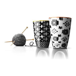 MENU - Nordic Wool Thermo Cups, Set of 2 - The knitted pattern on these mugs is inspired by warm wool sweaters and, much like a sweater, the thermo design keeps the contents of your mug warm. You'll feel cozy just looking at them, but will appreciate sipping from them too.