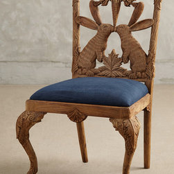 Handcarved Menagerie Armchair - With fine design in mind, and wildlife as our muse, we've given the classic Chippendale chair a modern update. Each seat is meticulously handcarved over the course of fourteen days, resulting in a woodland wonder that's a natural fit for your dining room.