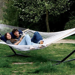 Fifthroom - Envirope Hammock - This completely comfortable rope hammock will hang on a hammock stand or between two trees to swing you away to a peaceful place.  But, you have no reason to feel self indulgent!  The Envirope design uses 100% recycled polyester fiber derived from old soda bottles that is crafted to hold the same soft touch as natural cotton.  Better yet? It�s mildew and mold resistant.  No worries, No harm, No stress!