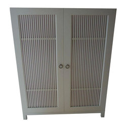 Pre-owned Cabana Armoire by DucDuc - This little baby is Retro Chic. Hang it, fold it in a drawer and then hide it all behind chic slated doors in this modern custom painted white wardrobe, purchased from DucDuc. Perfect for a guest room!    About the maker: DucDuc was born in a tiny town in Northwest Connecticut. Each DucDuc piece is custom made to order in a circa 1890's restored production facility.  DucDuc believes that manufacturing in the USA is the only way to control processes and materials used, monitor environmental impact, and provide customers with the level of quality that they expect. It is important that every piece of DucDuc furniture that makes it into someone's home is built with an attention to detail and quality that will ensure that product will last for years to come.    Note: There is very mild warping which is not noticeable on one of the panels and a couple of nicks at the bottom. Used for display, needs minor clean up.