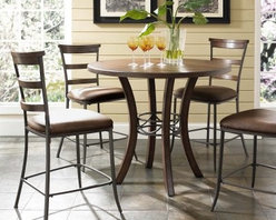 Hillsdale Cameron 5 Piece Counter Height Round Wood Dining Table Set with Ladder - The gorgeous chestnut brown wood finish of the Hillsdale Cameron 5 pc. Counter Height Round Wood Dining Table Set with Ladder Back Chairs will enhance the decor of just about any dining room. Modern in style with a metal accent in the table base and metal chair frames this dining set features wooden ladder-back rungs on the counter chairs. About Hillsdale FurnitureLocated in Louisville Ky. Hillsdale Furniture is a leader in top-quality affordable bedroom furniture. Since 1994 Hillsdale has combined the talents of nationally recognized designers and globally accredited factories to bring you furniture styling and design from around the globe. Hillsdale combines the best in finishes materials and designs to bring both beauty and value with every piece. The combination of top-quality metal wood stone and leather has given Hillsdale the reputation for leading-edge styling and concepts.
