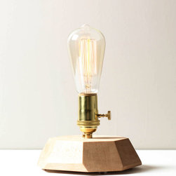 Edison Lamp - Bright ideas are meant to be exposed, much like the Edison Lamp. The design of the maple wood base is clean and simple, holding a 30-watt Edison bulb. Place on a side table, shelf, or desk.