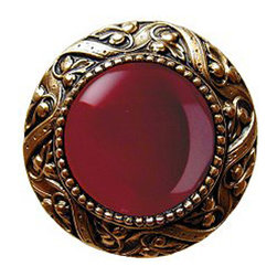 "Inviting Home - Victorian Knob (24K gold plate with red carnelian) - Victorian Knob in 24K gold plate with red carnelian semi-precious stone 1-3/8"" diameter Product Specification: Made in the USA. Fine-art foundry hand-pours and hand finished hardware knobs and pulls using Old World methods. Lifetime guaranteed against flaws in craftsmanship. Exceptional clarity of details and depth of relief. All knobs and pulls are hand cast from solid fine pewter or solid bronze. The term antique refers to special methods of treating metal so there is contrast between relief and recessed areas. Knobs and Pulls are lacquered to protect the finish. Alternate finished are available. Red Carnelian Semi-Precious stone. The word ""Carnelian"" came from Latin meaning ""horn"" because of the fresh color that could be observed. The group of stones is made of microcrystalline or crystalline variety of quarts. It is thought to increase stamina vitality and endurance as well as promote emotional balance. It was used in the past as a seal ring for imprinting on important documents because hot wax did not stick to Carnelian. The word ""Carnelian"" is also used to describe a certain shade of red which is the shade of red both for Campbell's Soup and Cornell University. Victorian Jewel pulls and knobs will allow you to have so much fun with the design. The pulls and knobs come in five different kinds of semi-precious stones: Black Onyx Tiger Eye Blue Sodalite Red Carnelian and Green Aventurine. You can even use all of the different colors of the semi-precious stones on one cabinet fa�ade�which would give it an eclectic and playful look."
