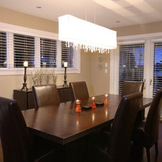 Transitional Dining Room by Synthesis Design Inc.