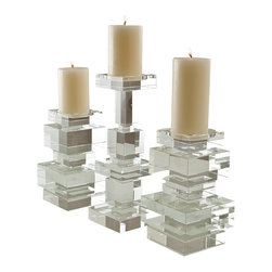 Global Views - Brilliant Pillar- Tall - These beautiful over scale lead crystal candleholders are as impressive as they are interesting. Designed to complement each other, the polished crystal blocks also stand alone as stunning sculptural statements. Each candleholder is wrapped in a black fabric bag and packed in a polished white gift box.