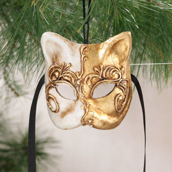 "Exposures - Venetian Cat Mask - Overview Capture the intrigue of Venice with this authentic miniature cat mask ornament. Beautiful with a touch of mystery, just like a real feline, each mask is handcrafted by Venetian artists using the same century-old papier-mch and plaster of Paris sculpting techniques they use on the treasured full-size masks. Evoking the playful spirit of Carnival on San Marco Square, it makes a perfect gift for cat lovers, mask collectors, and those who appreciate all things Italian. Features Papier-mch and plaster of Paris  Handcrafted in Italy    Specifications  Measures 4"" wide x 3"" high x 2"" deep"