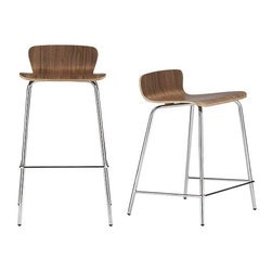 Felix Walnut Bar Stool/Counter Stool | Crate and Barrel - These handsome barstools continue the modern furniture tradition of using bent wood and a beautiful walnut veneer. The combination of wood and chrome tubular legs makes this stool a favorite pick for designers.