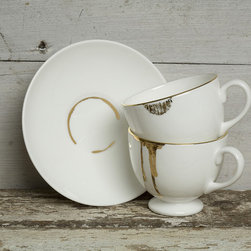 Drip Tease teacup and saucer - Designer Reiko Kaneko makes drips, drops, marks, and stains decorative details with her Drip Tease series. Kaneko gives tea spills on the edge of the cup, and a stain on the saucer a bit of glam by turning them into gold.
