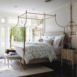 """Frontgate - Park Lane Canopy Bed - Can accommodate sheers or mosquito netting. Pairs with any decor from traditional to contemporary. Finials mimic the look of fine English sterling silver tea sets of the Regency period. Legs are fitted in sand-cast Marlborough feet. Height from floor to bottom of bed: 12"""".. The Park Lane Canopy Bed's clean, curvilinear profile and regal finials project English Regency styling, while its contemporary steel frame boasts a timeless silver-leaf finish. Arching in the headboard, footboard and stretchers offset the canopy's curves. Ivory velvet upholstery adorns the headboard and footboard, accentuating the soothingly cool palette. . . . . . Assembly required . Imported."""