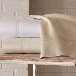 Virtuoso Sheets - A good choice for the ultimate, indulgent bed is 600 thread count sateen sheets.