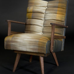 Milton Rocking Chair - Unique hand woven Thai silk upholstery fabrics grace Living Home Furniture's furniture line as well as Carla Pyle's nature-inspired signature upholstery designs. (WMC Photography)