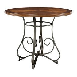 "Powell - Powell Hamilton Gathering Table in Medium Cherry - The Hamilton Gathering Table features an interesting curve and scroll designed bottom. The top is a sleek ""Brushed Faux Medium Cherry"" wood, while the bottom is a ""Matte Pewter and Bronze"" metal. This piece is sure to add interest and ample table space to any home decor. The perfect piece for your family to gather around. Some assembly required."