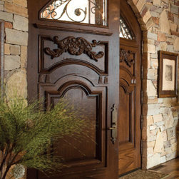 Custom Mahogany Arched Double Doors - Custom Solid Mahogany Arched Double Doors with clear glass and wrought iron grill on top and hand-carvings.