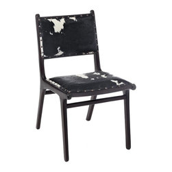 Roxy Dining Chair - The Roxy Dining Chair combines a mid-century wood frame with the country charm of a two-toned cow hide upholstered seat and back. It features an antique nailhead trim for additional detail and structure. Add an eclectic feel to your home with this stylish contemporary chair.