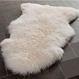 Genuine Sheepskin Rug, Single Pelt, Natural White Fur - A sheepskin throw is a versatile piece in any home. I have several and throw them on chairs, benches, the couch, the bed. One on each side of the bed will ensure that your feet get a cozy morning greeting.