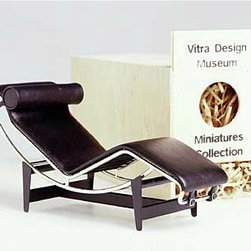Vitra Miniature - Le Corbusier Longue - This iconic piece of furniture is a classic example of International Style, which kicked off the modern movement. The real deal costs ten times as much, if you're jonesing to have one in your home, this mini model version is for you.
