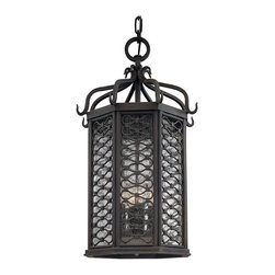 Los Olivos Large Exterior Pendant - This Spanish sconce has a hint of Moroccan style. The intricate iron woven frame is protected in an old-iron finish and inset with clear, seeded glass. Its soft glow adds a tranquil ambience to your exterior decor.
