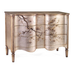 Portobello Serpentine Chest - Exquisite blossoms and delicate branches float atop a misto silver background that whispers of the waning light on a summer's eve in Trafalgar Square. Three generously sized drawers allow for easy containment of artifacts or personal belongings, while the darker accent moldings and wood-turned handles complete the refined and alluring aesthetic that is intricate without being overly embellished.