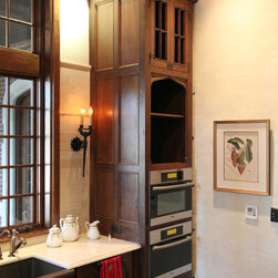 English Kitchen Tower - Custom cabinetry for built-in appliances.