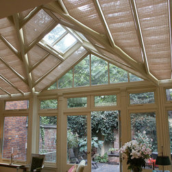 Conservatory Shades - Pinoleum shades in lean-to conservatory with feature gable - Photo by James Licata